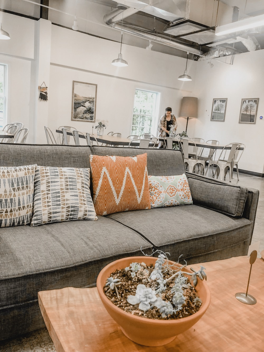 empty gray fabric sofa with throw pillows