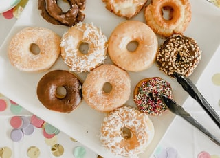 assorted doughnuts on white ceramic tray