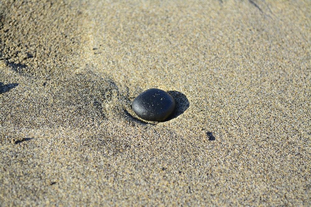 black rock on sand