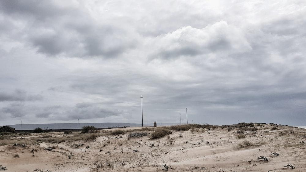 grey cloudy sky over brown desert