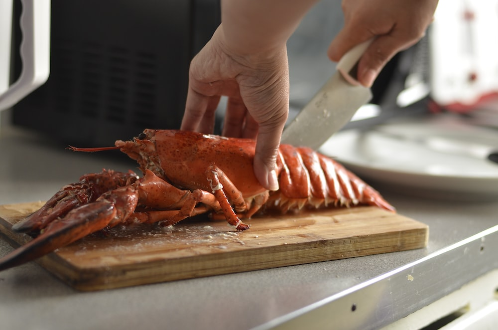 person cutting lobster