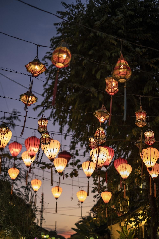 lighted lantern hanging over street