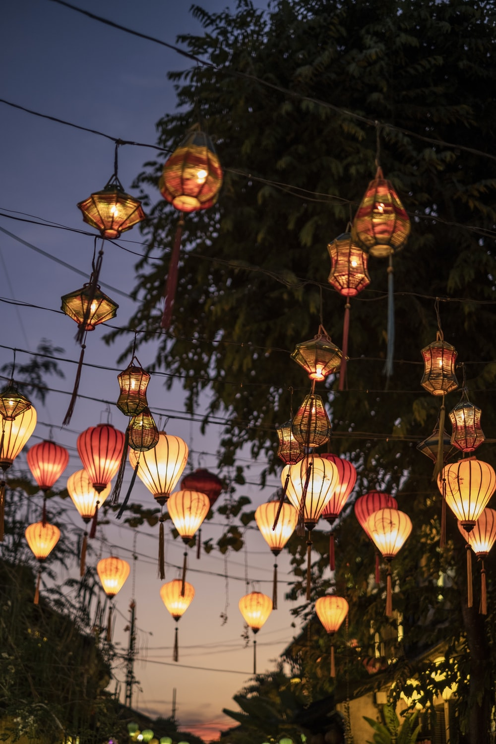 lighted lantern hanging over street