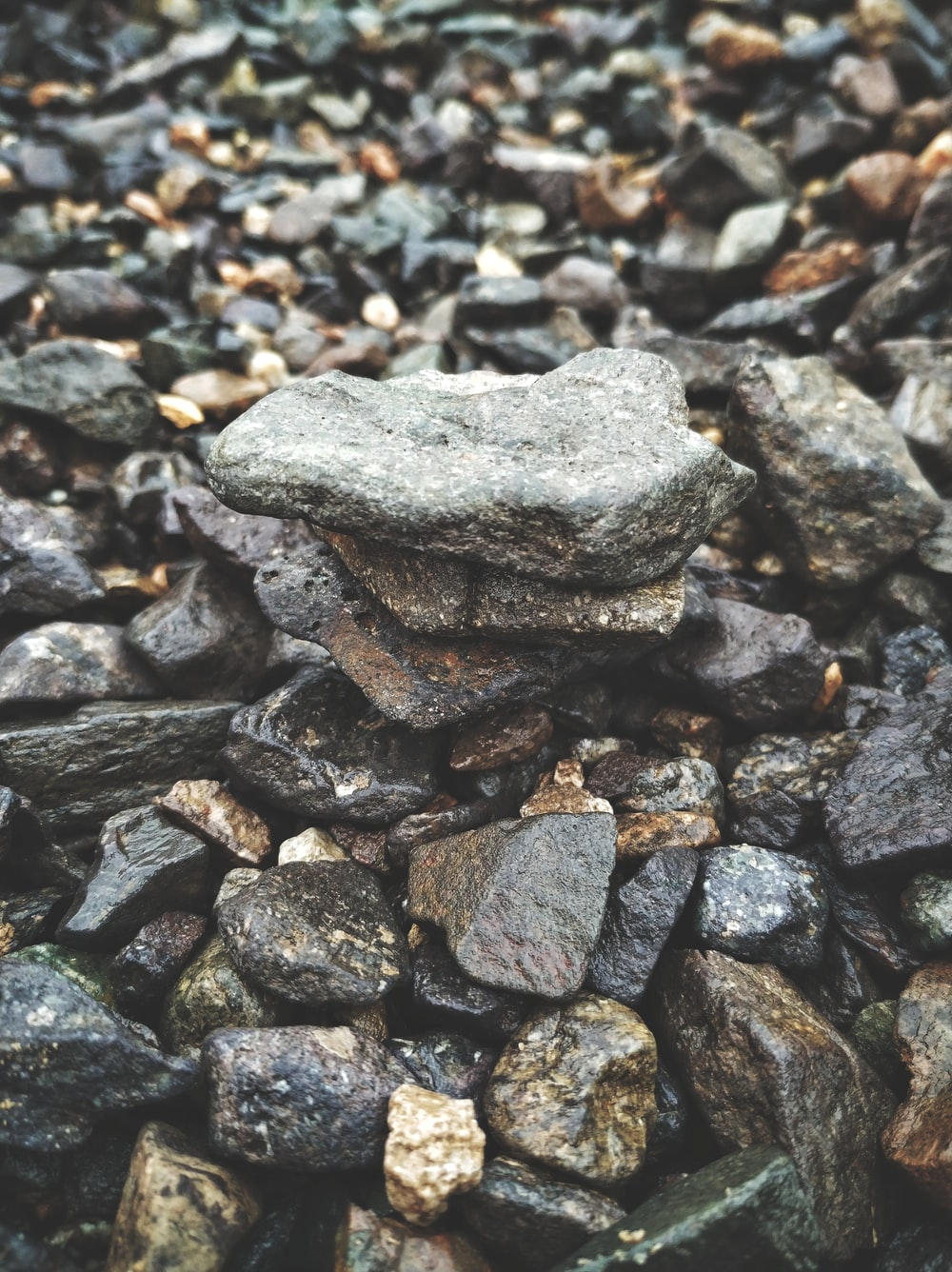 selective focus photography of stack stones during daytime