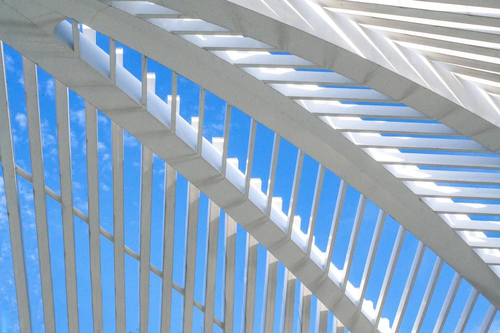 white railings under blue and white skies