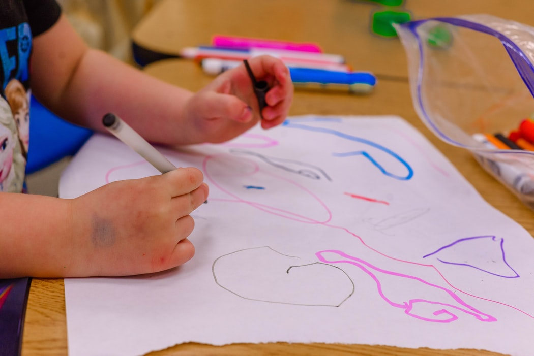 toddler benefiting from drawing at toddler class