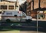 white ambulance near building