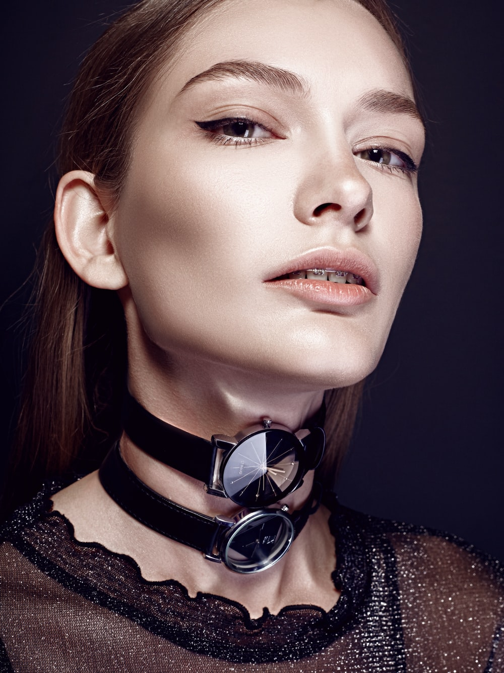 women's with two analog watches around neck