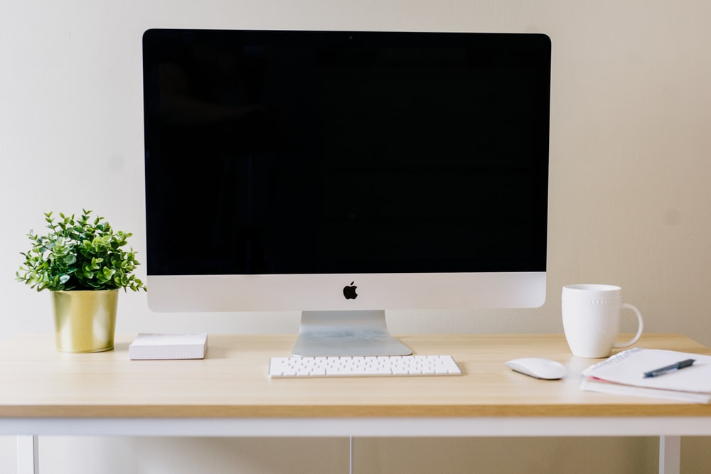 silver iMac, Apple Magic Keyboard, and Apple Magic Mouse