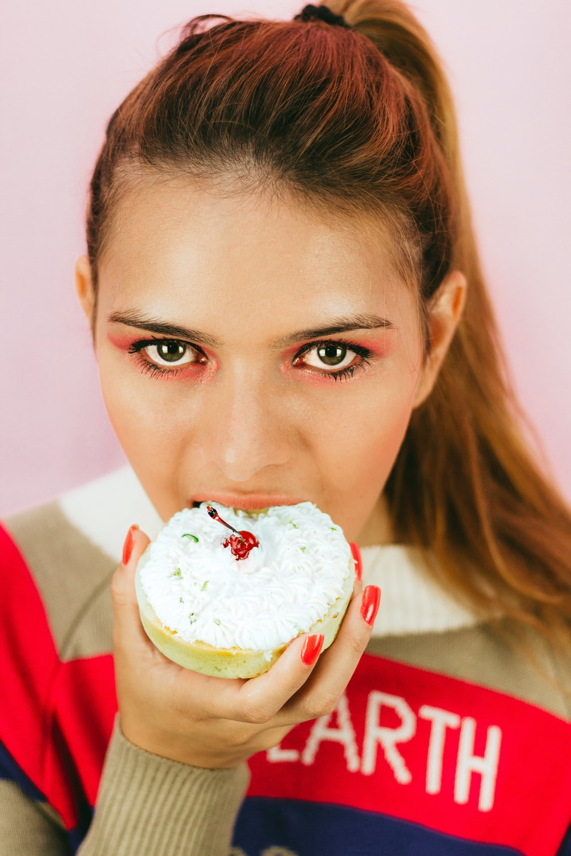 person eating dessert