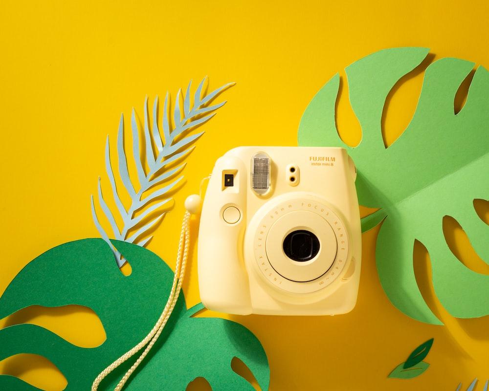 yellow Fujifilm instant camera
