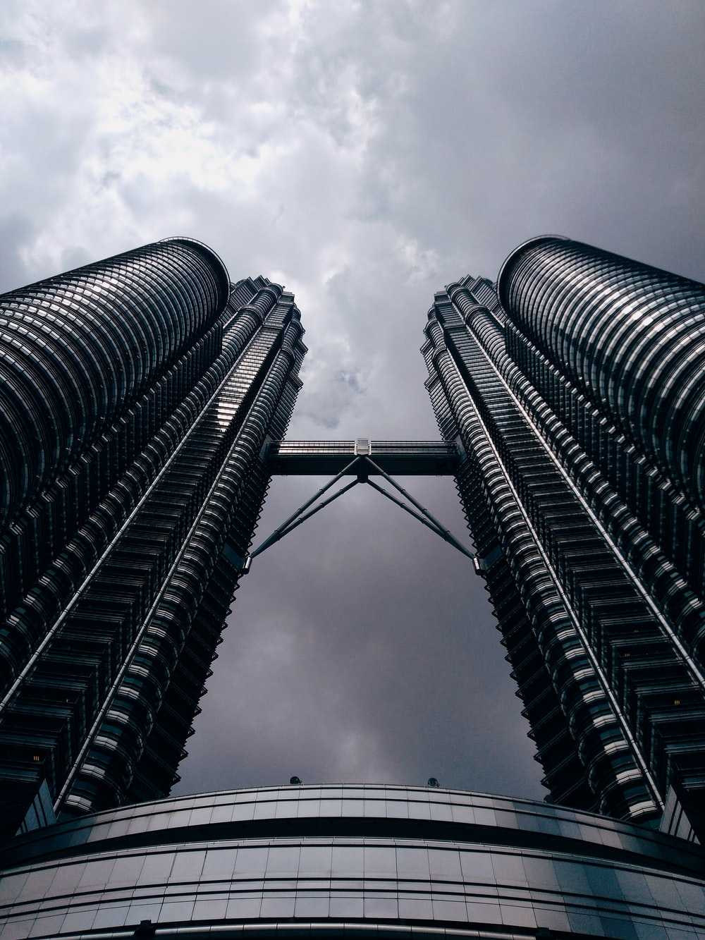 low angle grayscale photo of Malaysia Petronas towers