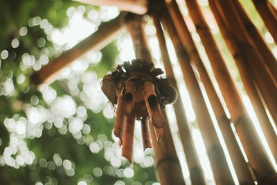 selective focus photography of wind chime