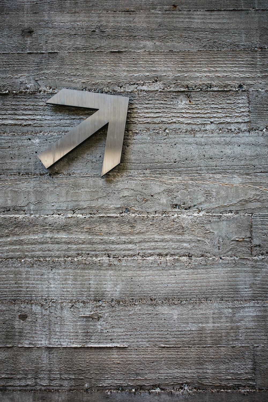 gray arrow on wall