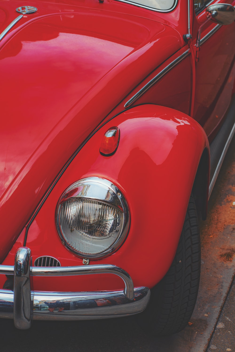 red Volkswagen Beetle coupe in close-up photo
