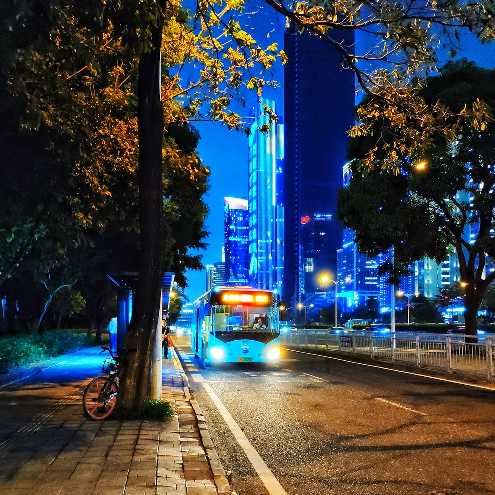 white bus on paved road
