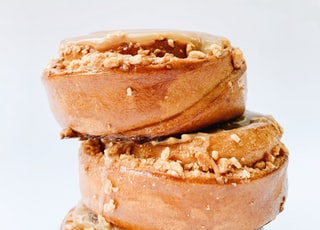 three brown doughnuts