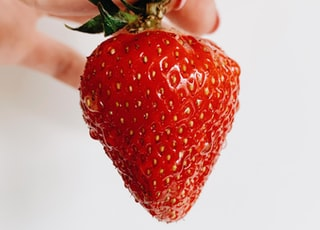 person holding strawberry
