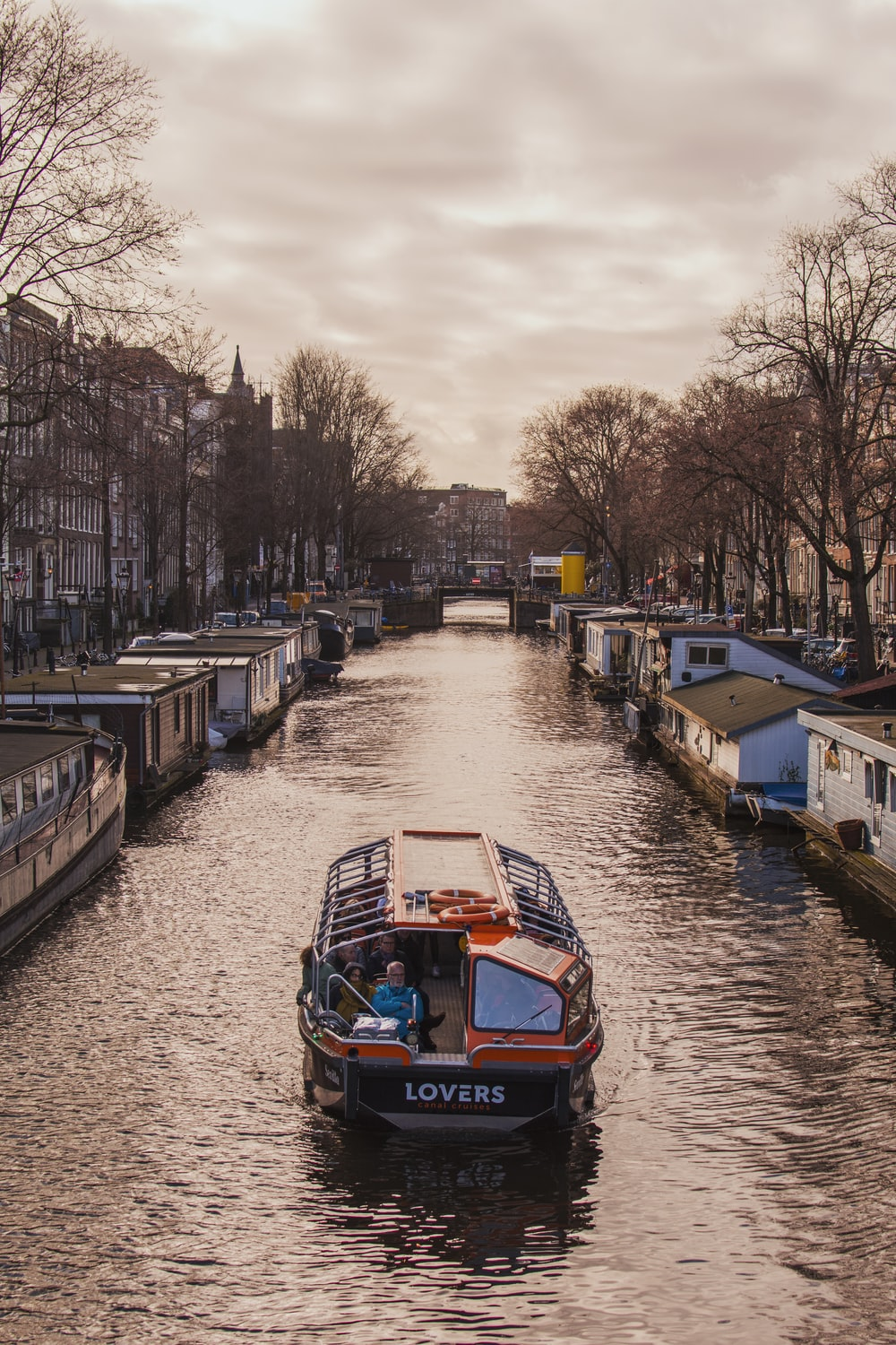 boat on canal during golden hour