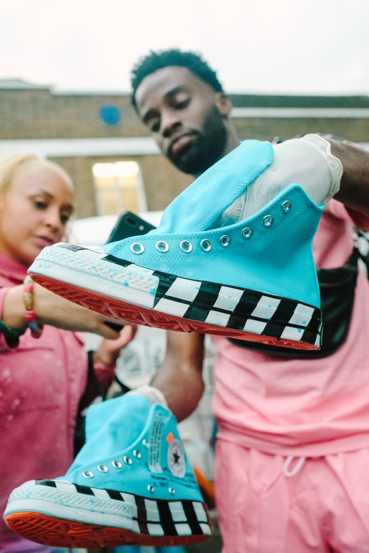 pair of blue Converse high-tops