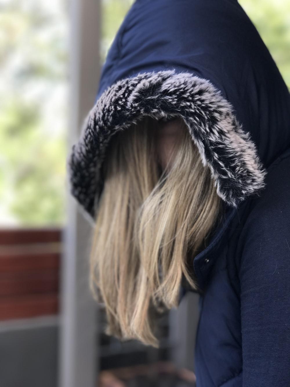 person wearing blue fur hoodie