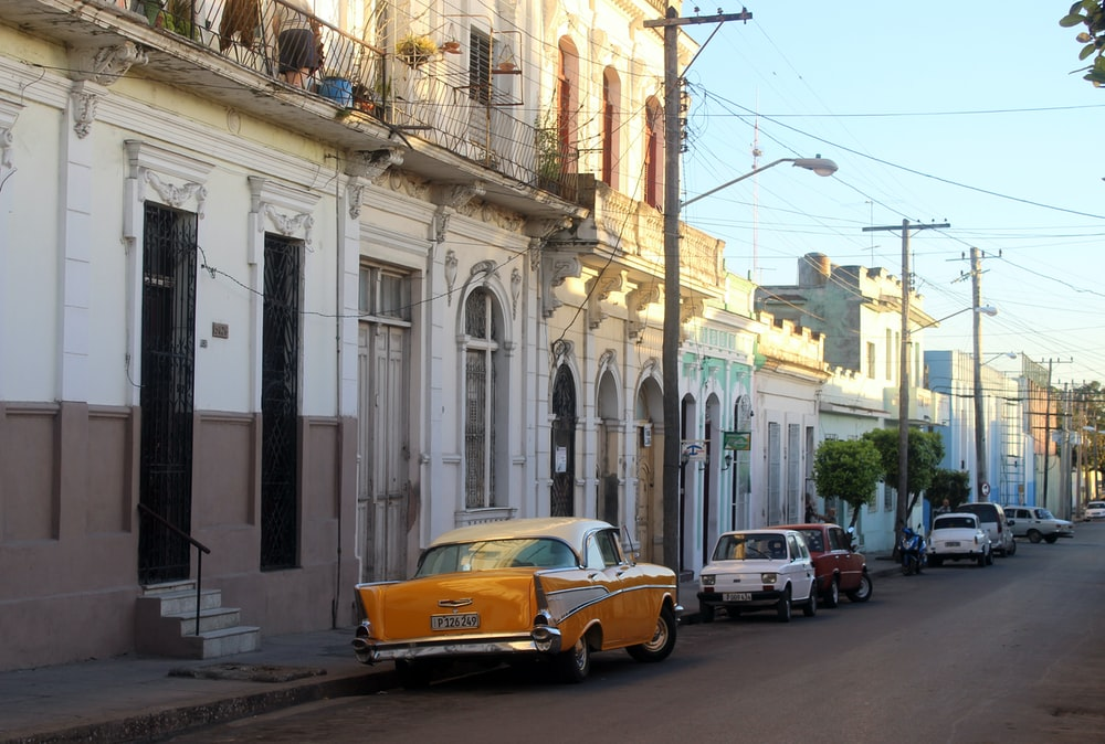 orange car beside building