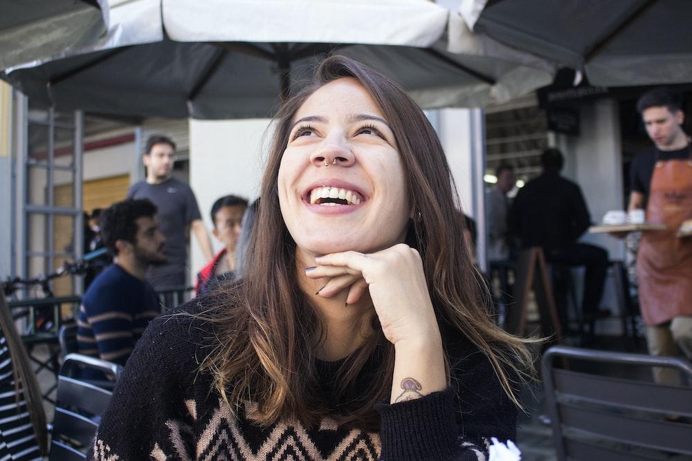 smiling woman wearing black sweater