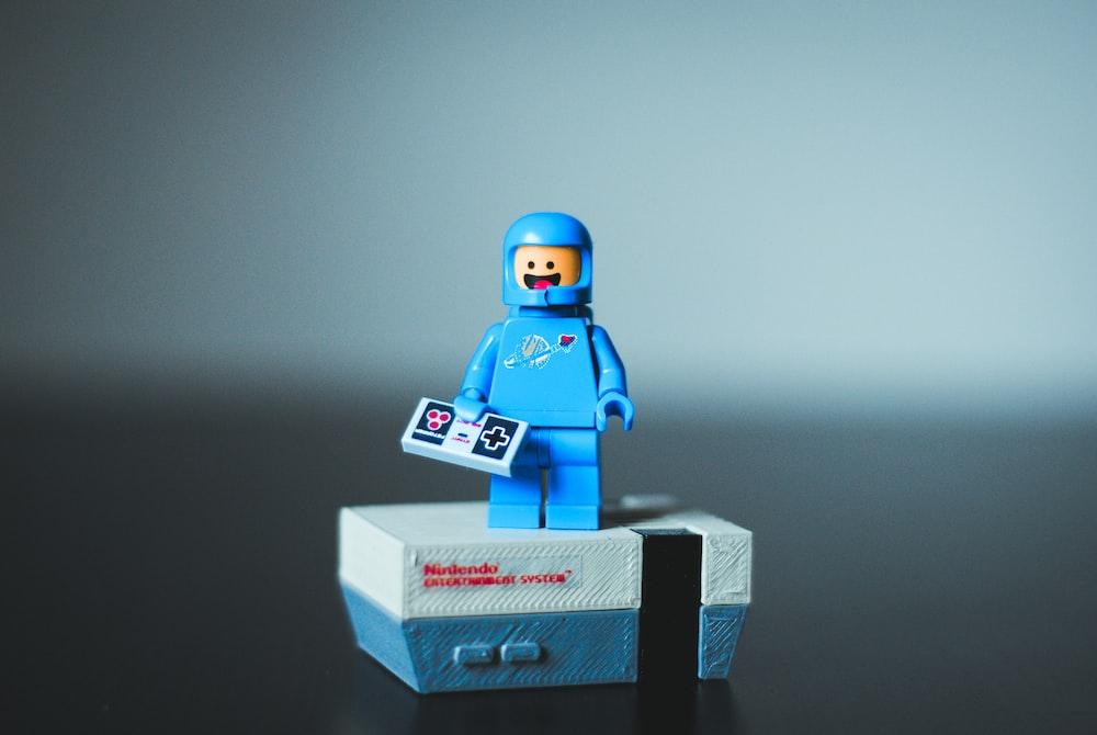 selective focus photography of blue LEGO minifigure