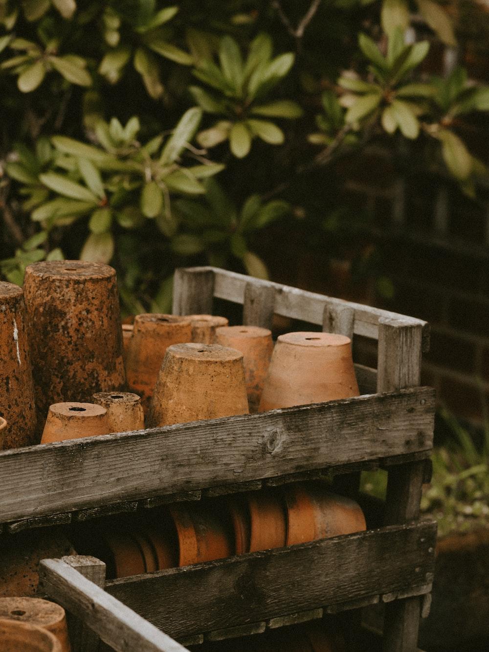 brown clay pot lot close-up photography