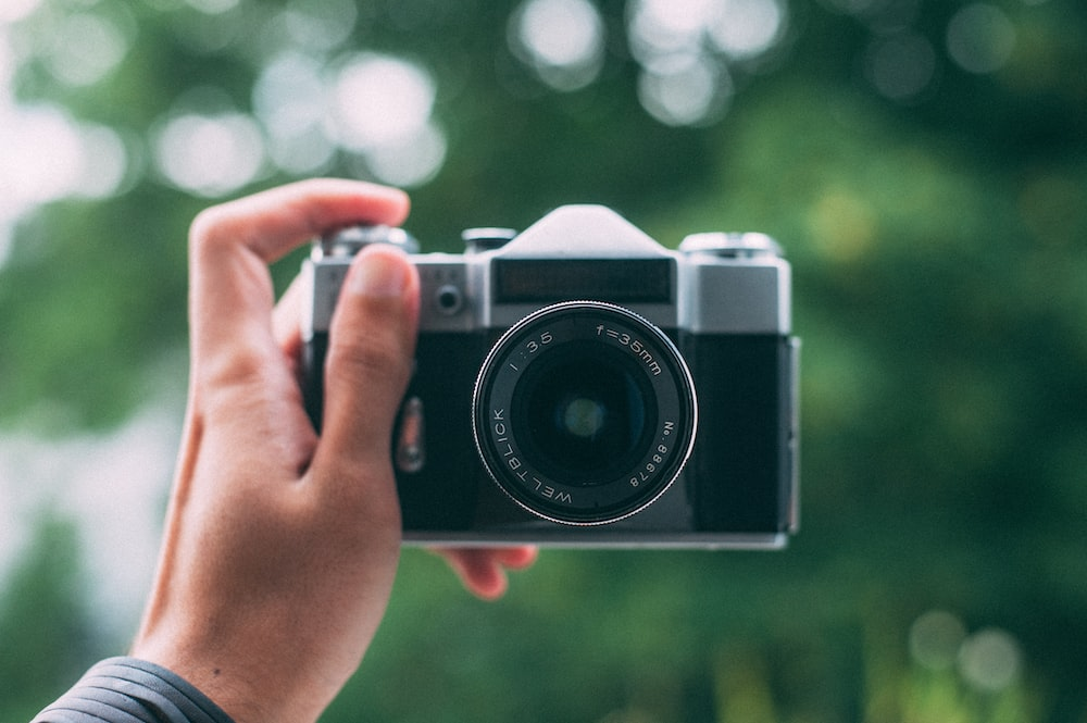 black and gray DSLR camera selective focus photography