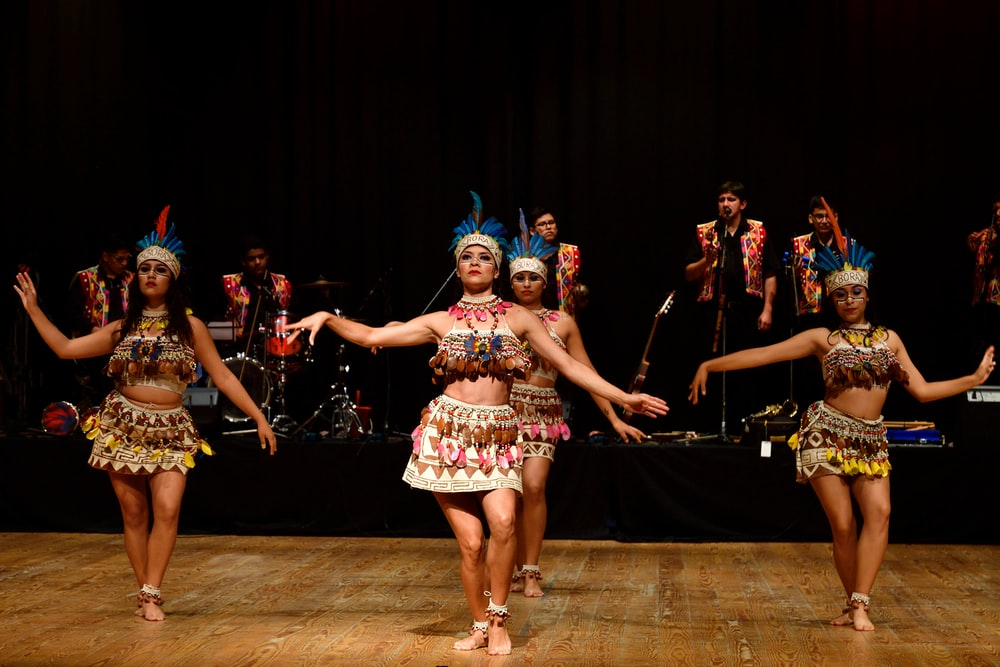 group of women dancing on stage