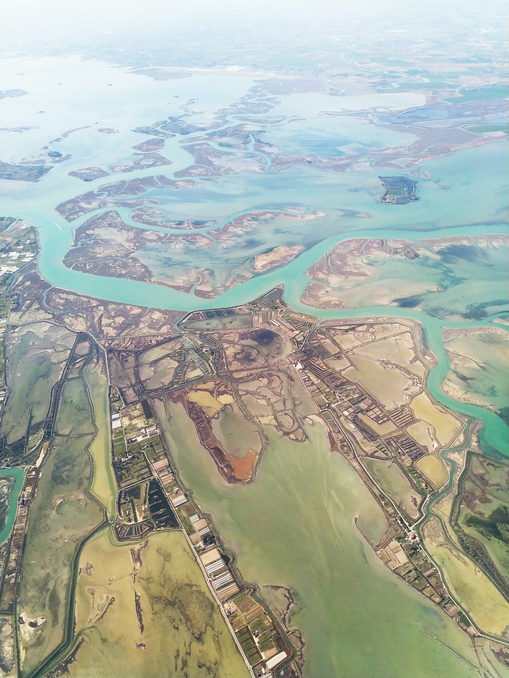 aerial photography of houses viewing field and sea