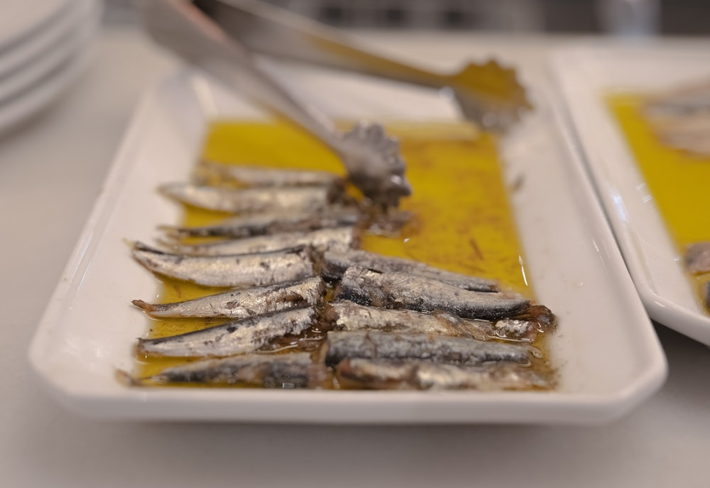 sardines in white serving platter