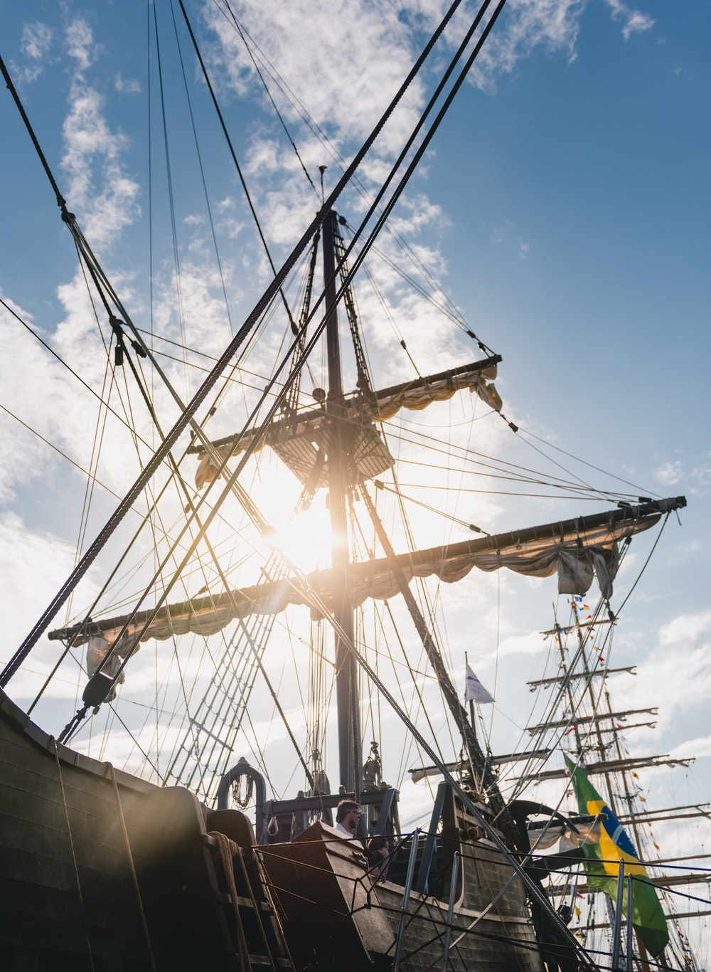 brown wooden galleon ship with Brazil flag