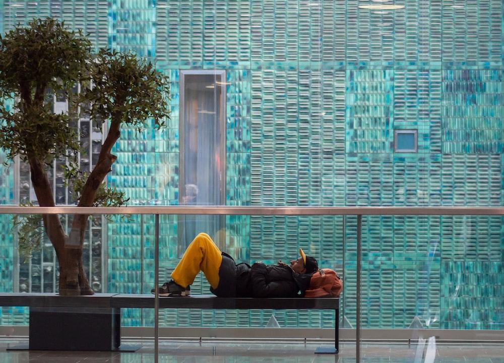 man lying on bench
