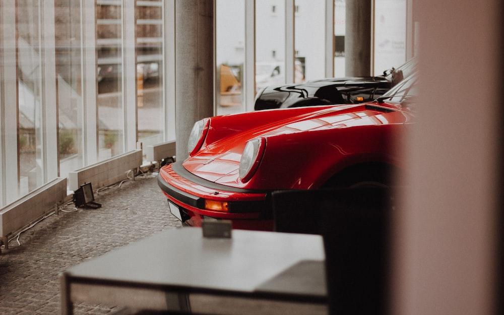 red car near table