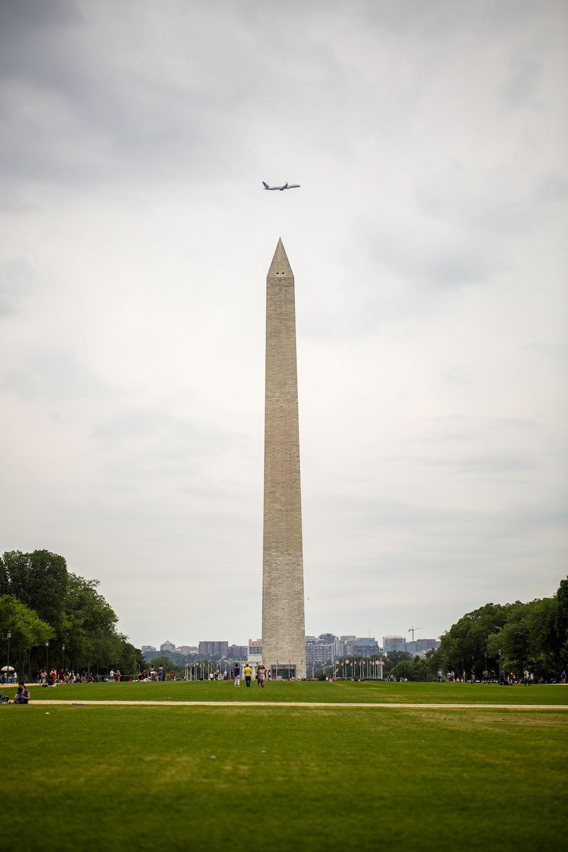 airplane over obelisk monument