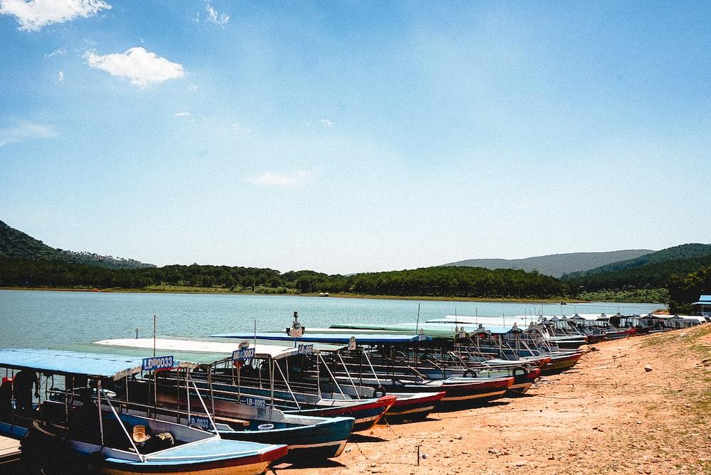 boats on seashore near ocean