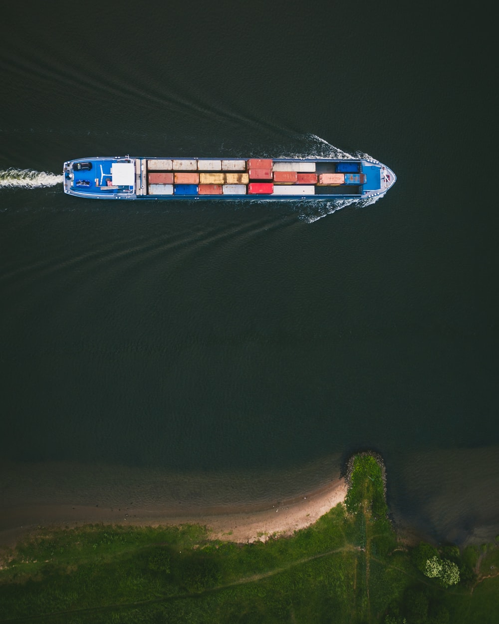 cargo ship on body of water