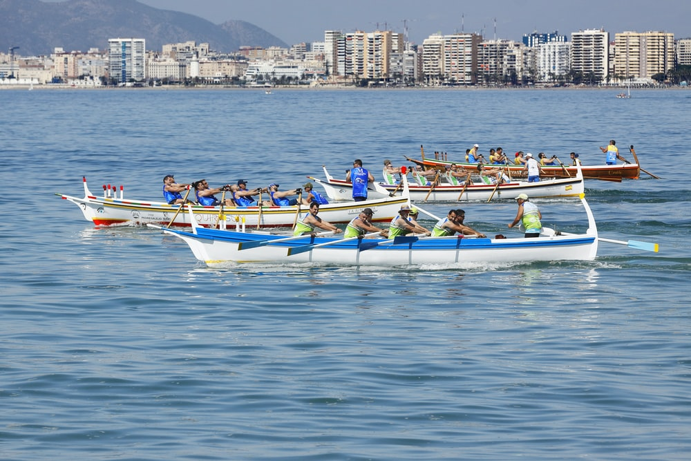 people riding boat during daytime