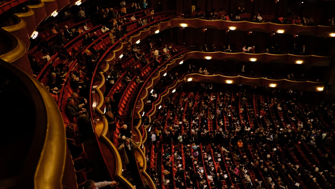 Audience waiting, seated, in a theatre, opera house in New York.