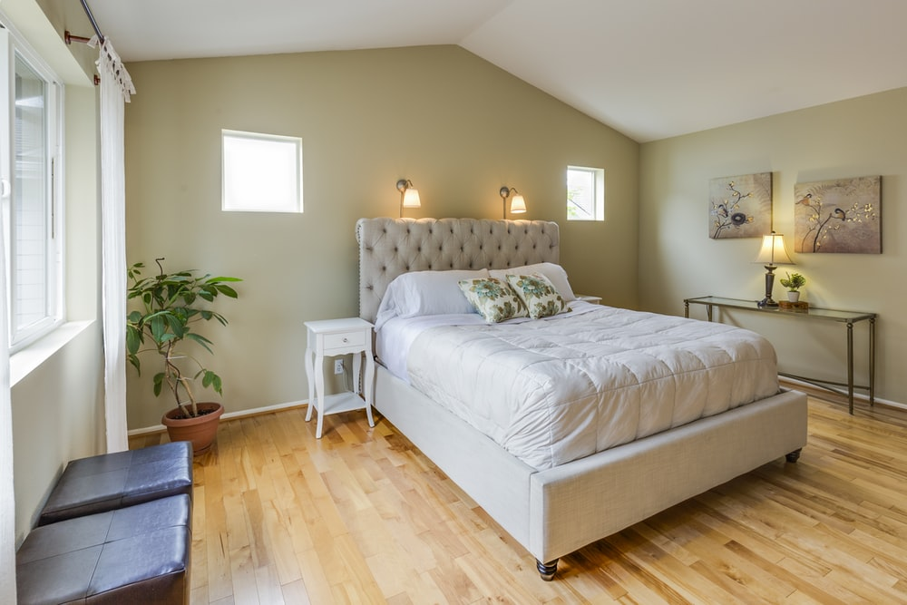 tufted white upholstered bed