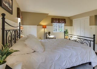 white mattress sheet and four white pillows