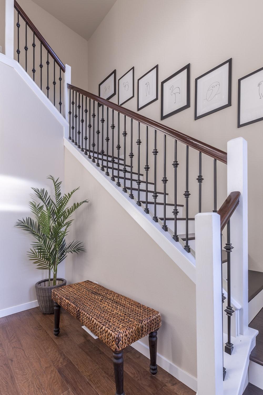brown wooden bench near white stair