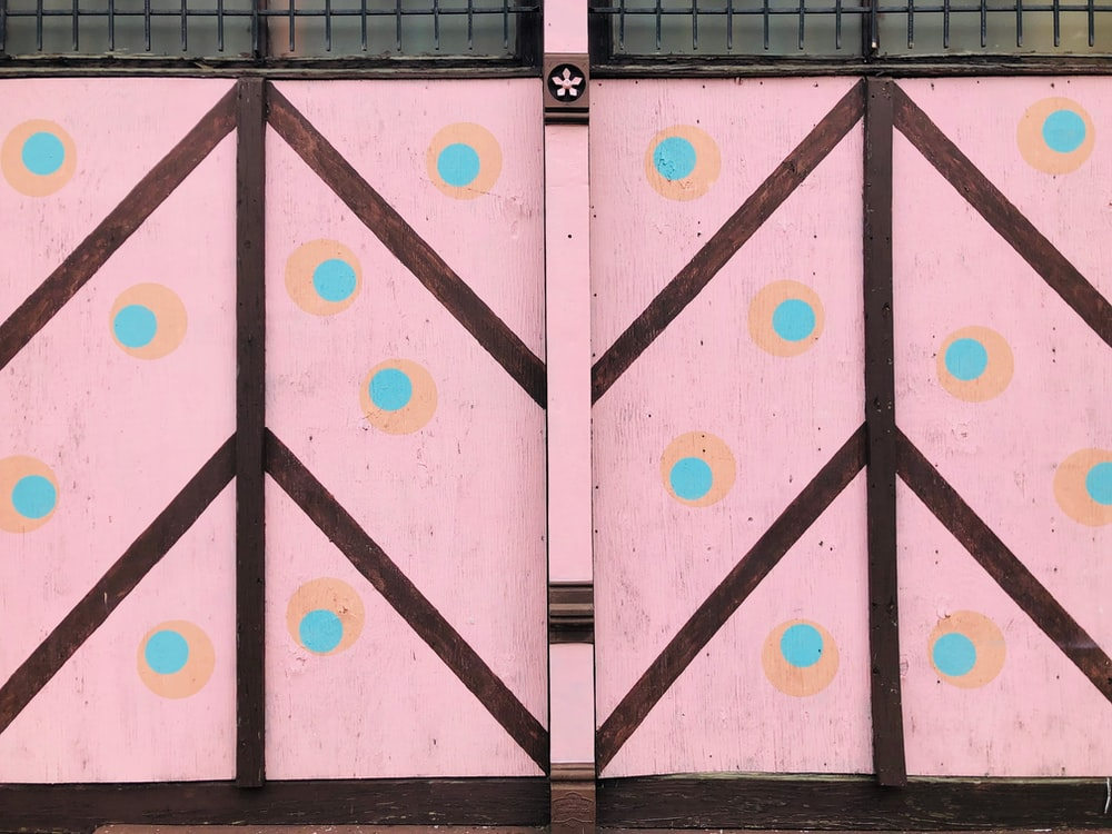 pink, teal, and blue polka-dot curtains