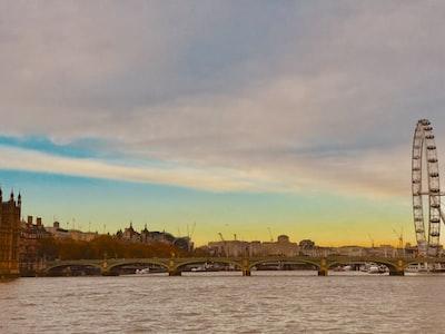 London Tower Bridge under blue and gray skies