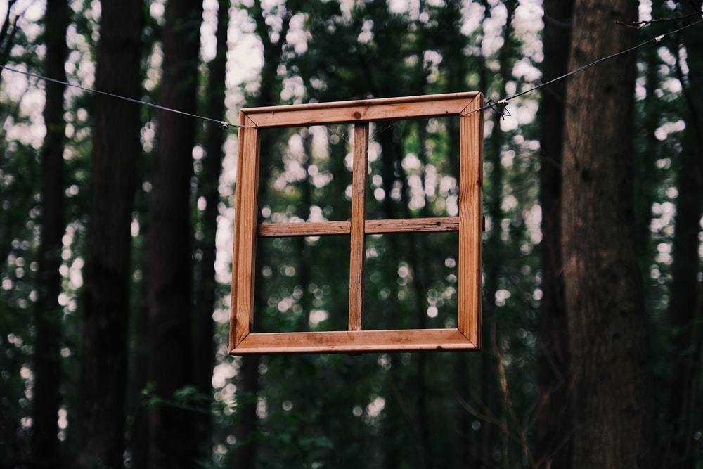 square brown wooden window panel