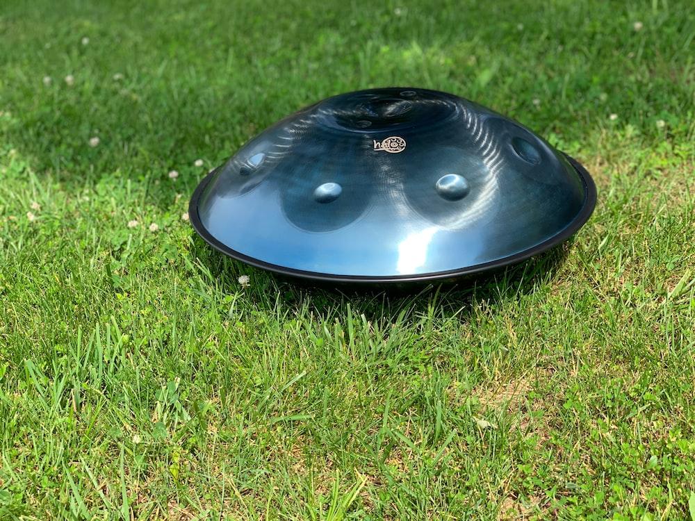 round gray firepit on grass