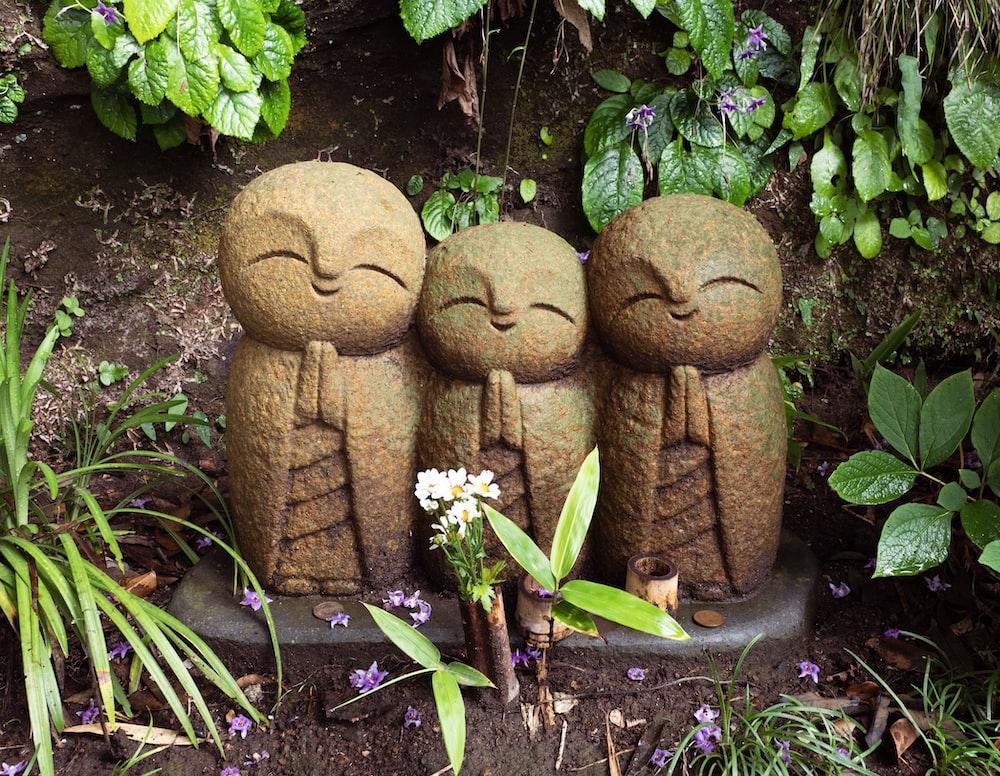 brown wooden bird figurines