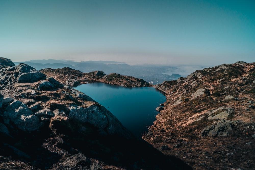 mountain near body of water during daytime